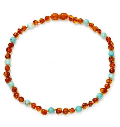 Mon premier collier - Ce bijou est créé avec de véritables perles d'ambre. Chaque perle est séparée par un nœud de sureté, permettant de porter le collier en toute sécurité.  Chaque collier est vendu avec son certificat d'authenticité. Nous vous invitons à faire preuve de toute votre vigilance de parents et à vous assurer régulièrement du bon état du bijou.