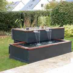 Bassin Biotonome - <p>Le Bassin Biotonome est un bassin d'ornement destiné à l'aménagement de vos terrasse et jardin.</p> <p>Le Bassin Biotonome se compose d'un bassin, d'une lagune plantée et d'un système de filtration. Il existe un large choix d'agencements et de dimensions possibles.</p> <p>Les lagunes plantées sont aménagées d'une multitude de plantes aquatiques diverses et colorées, agrémentées d'une lame d'eau ces dernières apporteront à votre extérieur une petite oasis de tranquilité.</p> <p></p>