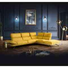 Canapé ALADIN - Design et détente. Haut dossier avec repose-tête ajustable et accoudoirs relevable.