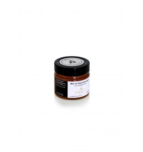 Miel de Fleurs Sauvages - <p>Produit &agrave; partir de mi-juin, c&rsquo;est le miel d&rsquo;&eacute;t&eacute; du Limousin par excellence. Nos colonies d&rsquo;abeilles profitent de la floraison de la ronce dans nos sous-bois taillis et bosquets&nbsp;et du ch&acirc;taigner embl&egrave;me du Limousin. En r&eacute;sulte, un miel bois&eacute; avec une pointe d&rsquo;amertume et une tr&egrave;s belle robe ambr&eacute;e.</p>
