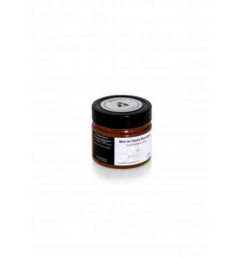 Miel de Fleurs Sauvages - <p>Produit à partir de mi-juin, c'est le miel d'été du Limousin par excellence. Nos colonies d'abeilles profitent de la floraison de la ronce dans nos sous-bois taillis et bosquetset du châtaigner emblème du Limousin. En résulte, un miel boisé avec une pointe d'amertume et une très belle robe ambrée.</p>