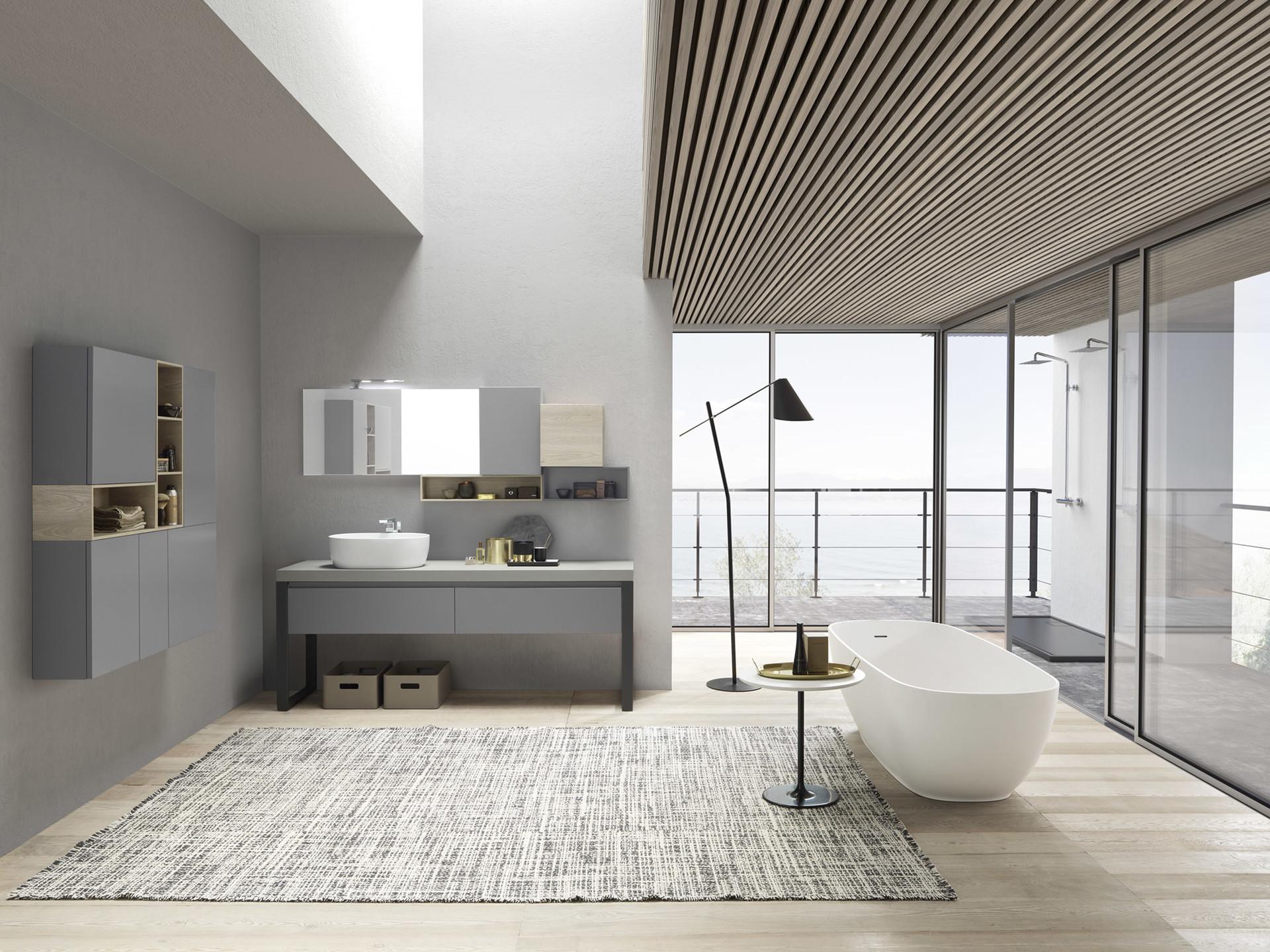 Salle de bain tendance dans les tons gris, baignoire et douches